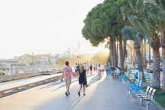 People walking in a summer afternoon sunlight in Cannes Stock Image