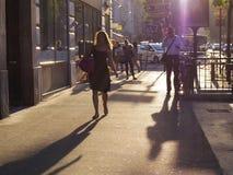 People walking at sun set in Paris Royalty Free Stock Photos