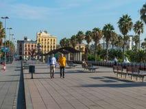 People walking on a sunny morning,  the Walk 'Moll de la Fusta', Royalty Free Stock Photos