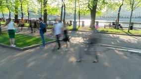 People walking in a park. Panoramic timelapse motion. People walking in a sunny park. Panorama from left to right timelapse motion stock video