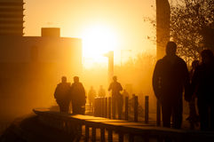 People walking at sunset Royalty Free Stock Photography