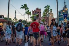 People walking on Sunset Boulevard at Hollywood Studios in Walt Disney World area 2. Orlando, Florida. May 20, 2019. People walking on Sunset Boulevard at stock photos