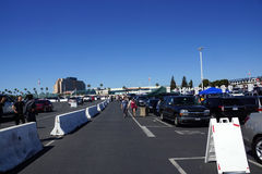 People walking and tailgate in parking lot before the start of W Royalty Free Stock Images