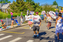 People walking in the 39th Annual Provincetown Carnival Gods and Goddess Parade on Commercial Street in Provincetown, Massachusett. S August 17, 2017 USA Royalty Free Stock Photos