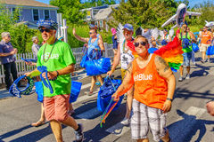 People walking in the 39th Annual Provincetown Carnival Gods and Goddess Parade on Commercial Street in Provincetown, Massachusett. S August 17, 2017 USA Stock Photos
