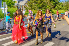 People walking in the 39th Annual Provincetown Carnival Gods and Goddess Parade on Commercial Street in Provincetown, Massachusett. S August 17, 2017 USA Royalty Free Stock Photography