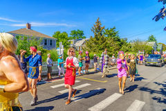 People walking in the 39th Annual Provincetown Carnival Gods and Goddess Parade on Commercial Street in Provincetown, Massachusett Royalty Free Stock Photos