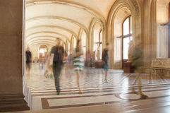 People walking throw the Louvre museum halls Stock Image