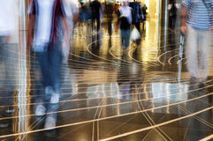 People walking thru the mall. A shopping mall. Long exposure for intentional motion blur of people Stock Images