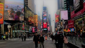 Times Square in New York city. People are walking on Times Square in New York city Royalty Free Stock Image