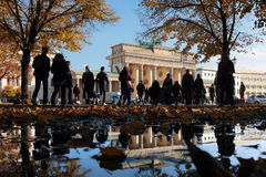 People walking to Brandenburg Gate Stock Photo