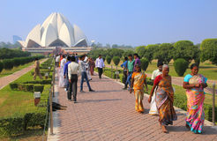 People walking to and from Lotus temple in New Delhi, India. It serves as the Mother Temple of the Indian subcontinent and has become a prominent attraction in Stock Images