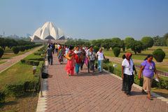 People walking to and from Lotus temple in New Delhi, India. It serves as the Mother Temple of the Indian subcontinent and has become a prominent attraction in Royalty Free Stock Photos
