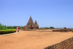 People walking to shore temple at Mahabalipuram, Tamil Nadu, India. The shore temple is a UNESCO world heritage site royalty free stock photos