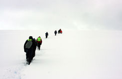 People walking to the snow horizon Stock Photo