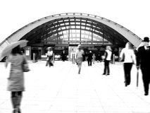 People walking to the tube station, London. People walking to the underground station, London (high key motion blur Royalty Free Stock Images