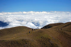People Walking on the Top of the Mountain on Daytime Royalty Free Stock Images