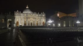 People walking towards Saint Peters Basilica church in Vatican, night time lapse stock footage