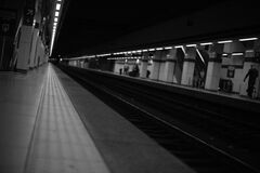 People Walking on Train Station Greyscale Photography Royalty Free Stock Photos