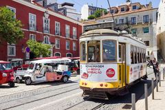 People walking by the tram line in the center of the city, Lisbon, Portugal Stock Photos