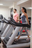 People walking on treadmill stock photography