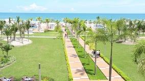 People walking at tropical beach resort.  stock video footage