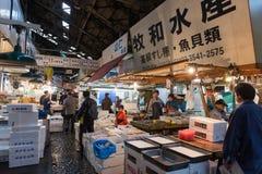 People walking in Tsukiji fish market Royalty Free Stock Images