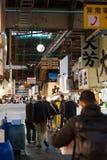 People walking in Tsukiji fish market Stock Photo