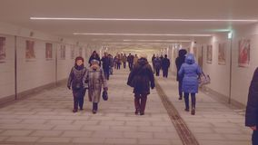 People walking in tunnel of underground. In Moscow stock footage