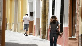 People walking in a typical andalusian street. People walking in a typical street village andalusian stock video footage