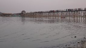 People walking on the Ubein bridge in Mandalay, Myanmar.  stock video footage