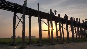 People walking on the Ubein bridge in Mandalay, Myanmar stock video footage