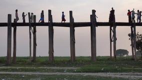 People walking on the Ubein bridge in Mandalay, Myanmar stock video