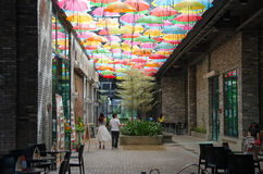 People walking under the decorated roof. Umbrella Stock Images