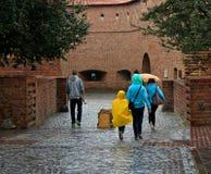 People walking under the rain in Krakow Stock Photography
