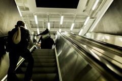 People walking up on escalator Royalty Free Stock Image
