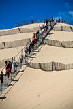 People walking up on one of the biggest dune of Europe, Pyla, Pilat, France Royalty Free Stock Photography