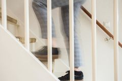 People walking up the stairs at home. People walking up the stairs in a clean house Royalty Free Stock Photography
