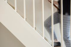 People walking up the stairs at home. People walking up the stairs in a clean house Stock Photography