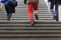 People walking up steps. View from back stock photography