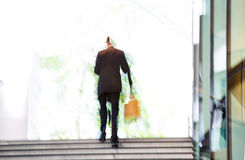 People walking up to stairs, blur background. LondonPeople walking up to stairs, blur background. London. People walking up to stairs, blur background. London Stock Photography