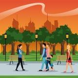People walking urban city park brench lamp postlight trees sunset Stock Image