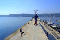 People walking on Varna breakwater Royalty Free Stock Photography