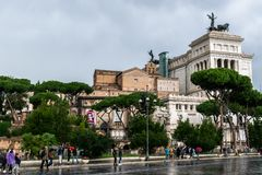 People walking on Via Dei Fori Imperiali Street. Vittorio Emanuele II Monument Alter Of The Fatherland in background. stock photo