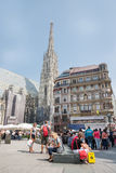 People walking  in Vienna. VIENNA, AUSTRIA - AUGUST 3, 2015: people walking in the historic Stephansplatz center of Vienna on august 3, 2015 in Vienna Stock Image