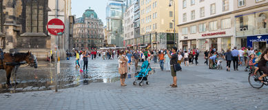 People walking  in Vienna. VIENNA, AUSTRIA - JULY 31, 2015: people walking in the historic Stephansplatz center of Vienna on  july 31, 2015 in Vienna Royalty Free Stock Photography