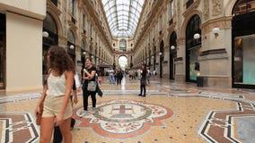 People walking in Vittorio Emanuele II Gallery. Milan, Italy - September 05 2014: People walking in Vittorio Emanuele II Gallery - the oldest shopping mall in stock video
