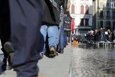 People walking on the walkway Stock Images