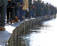 People walking on the walkway. In Venice during at high tide Stock Photography