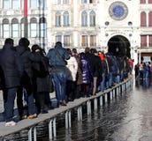 People walking on the walkway Royalty Free Stock Photos